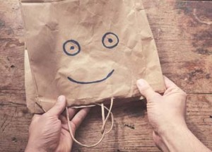 Smiling face on paperbag